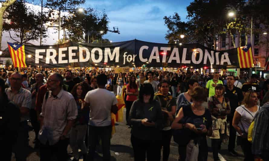 Protesters gather to demonstrate against the Spanish federal government's move to suspend Catalonian autonomy.