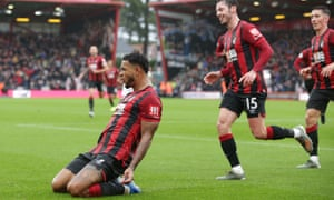 Joshua King of Bournemouth celebrates with teammates after scoring the winner.