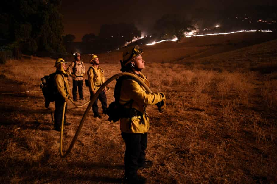Firefighters attempt to extinguish the Hennessey fire. There are currently more than 300 known fires in the state.