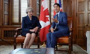 Theresa May talking to Justin Trudeau