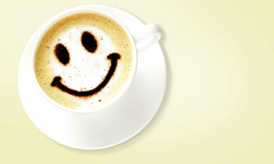 A smiley face on a cup of coffee