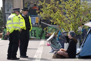 Police talking with a protester on Waterloo Bridge