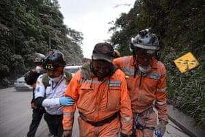 A volunteer firefighter weeps after leaving El Rodeo village
