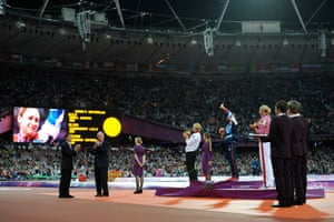 A tearful Jessica Ennis waves to the crowd after hearing the National Anthem during her gold medal presentation