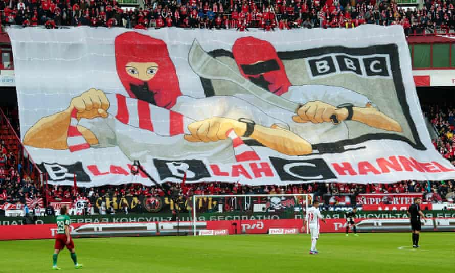 Spartak Moscow fans hold a giant banner during a game against Lokomotiv Moscow.