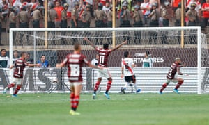 Flamengo's Gabriel Barbosa (right) wheels away in celebration after scoring their equaliser.
