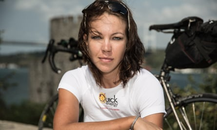 A close-up of Juliana Buhring, her bike behind her.