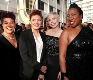 Activist Rosa Clemente, actors Susan Sarandon and Michelle Williams and activist Tarana Burke arrive to the 75th Annual Golden Globe Awards