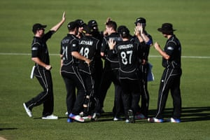 Mitchell Santner of New Zealand celebrates with teammates for the wicket of Marcus Stoinis of Australia during game three of the One Day International series between New Zealand and Australia at Seddon Park.