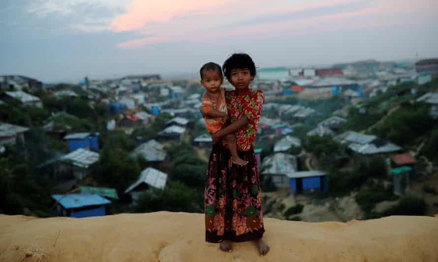 Rohingya refugee children pose for a picture at the Balukhali camp in Cox's Bazar