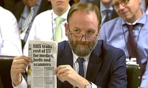 Simon Stevens holds up a copy of the Daily Mail as he gives evidence to a Commons committee in January.