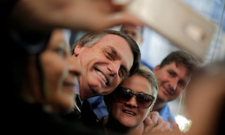 Jair Bolsonaro poses for a selfie at the National Congress in Brasilia during the campaign