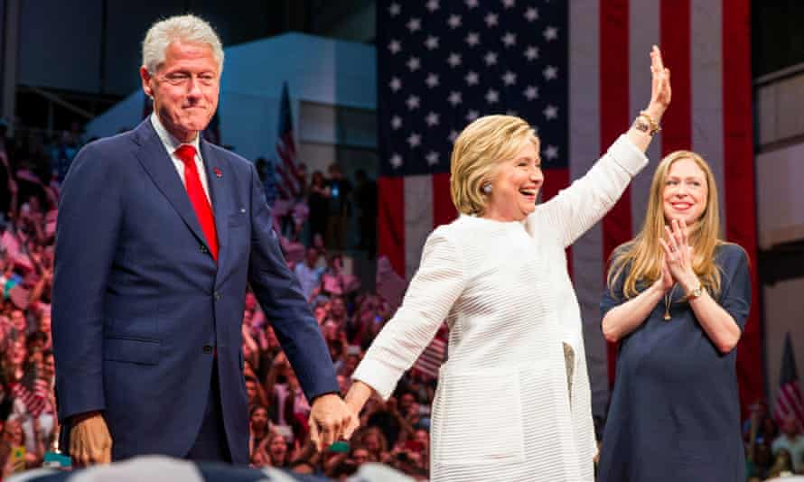 Hillary Clinton flanked by Bill and daughter Chelsea