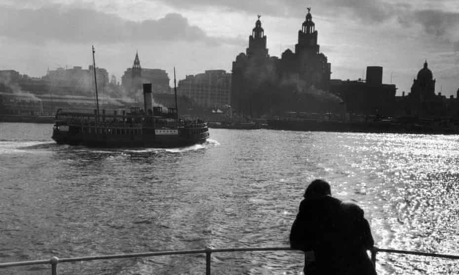 A man on the Mersey ferry in 1954 with the Liver Building in the background