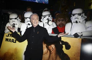 C-3PO, aka Anthony Daniels poses in front of his fans