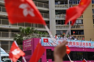 People take part in a parade to mark the 23rd anniversary of Hong Kong's return to Chinese rule