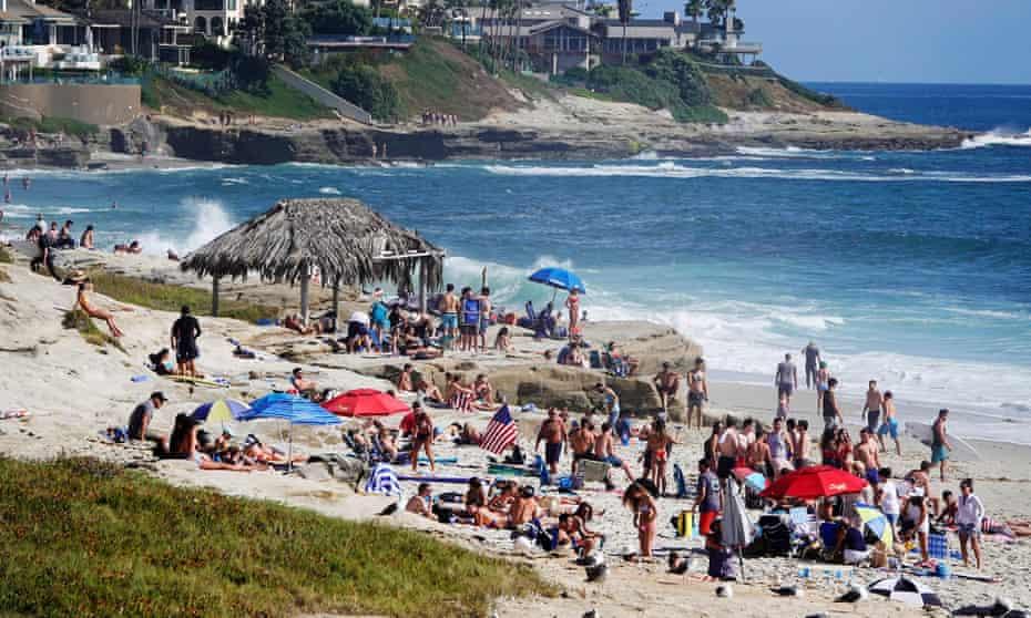 People pack La Jolla beach in California on 3 July.