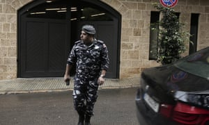 A policeman leaves the Beirut residence of former Nissan chairman Carlos Ghosn on 31 December.
