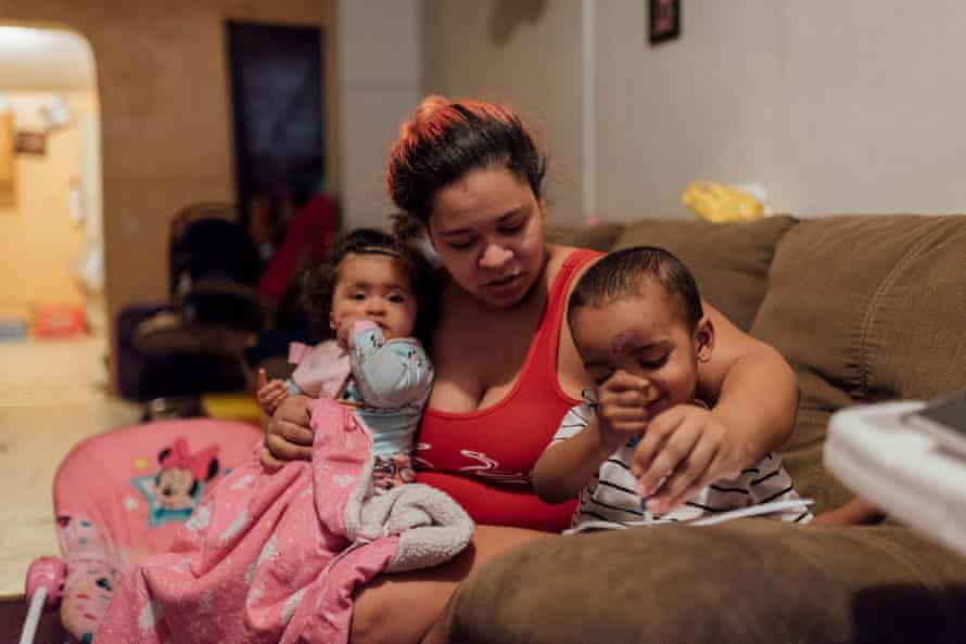 Ashley Melecio, center, sits with her daughter Da'miaa Morales, left, and her son Da'ahmeer Melecio-Martinez at her home in Chester, PA., on Friday, January 18, 2019. She says she doesn't let her kids play outside because of all the traffic and because of how bad it smells. Residents live right behind the Covanta incinerator that is now burning around 200 tons of garbage and recycling a day.