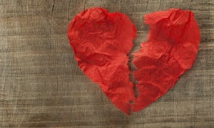Broken heart made of curled red paper