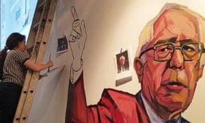 Paige Emery paints a mural of Bernie Sanders