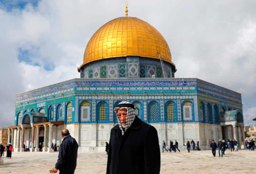 A Palestinian worshipper walks past the Dome of the Rock Mosque in Jerusalem.