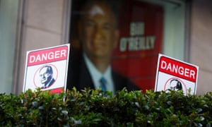 Signs with Bill O'Reilly's face in front of Fox News Channels' studios in New York, New York on Tuesday.