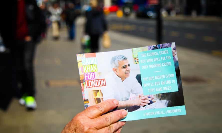 A campaigner holds a leaflet for Sadiq Khan's London mayoral bid.