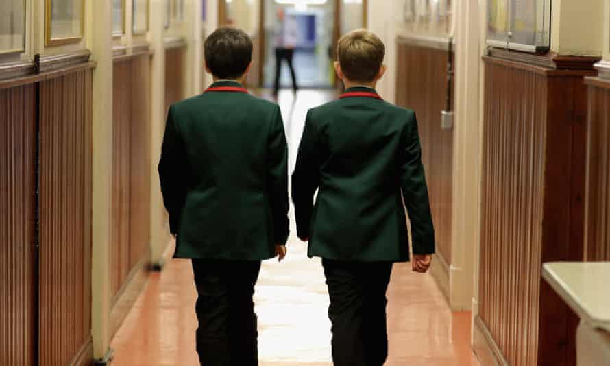 Schoolboys make their way to class at Altrincham Grammar School for Boys.