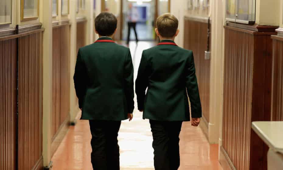 Two boys in grammar school uniforms