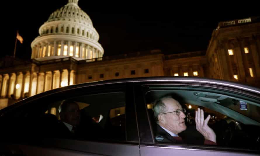 Lamar Alexander leaves the Trump impeachment trial.