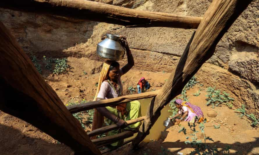 Villagers collect water from an almost dried up well in Mhaismal village in Surgana, western India. The drought is affecting 21 districts in Maharashtra.
