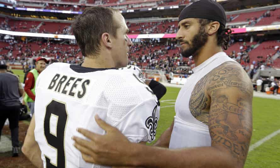 Drew Brees talks to Colin Kaepernick after a game in 2016. The Saints quarterback on Wednesday said he disagreed with Kaepernick's protest during the national anthem