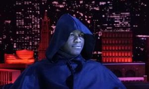 John Boyega wearing a massive monastic cloak on on NBC's The Tonight Show Starring Jimmy Fallon