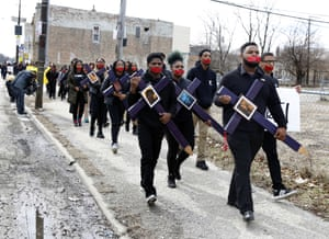 High school senior D'Angelo McDade, front right, leads a march in Chicago to protest gun violence.