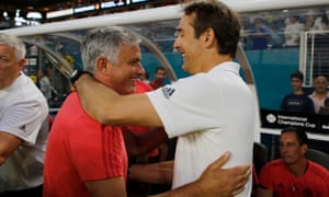 Real Madrid coach Julen Lopetegui, right, greets Manchester United coach Jose Mourinho.