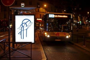 A poster by street artist Paul Insect at a bus stop in Paris,
