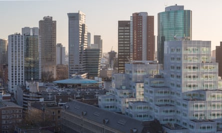 Sim City stack … The Timmerhuis by OMA rises on to Rotterdam's skyline like a pixelated mountain.