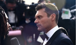 Ryan Seacrest, working the red carpet despite allegations of sexual abuse