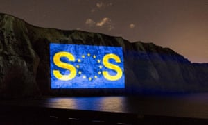 Anti-Brexit group Led By Donkeys beams an SOS message on to Dover's white cliffs, calling for a Brexit extension and a confirmation vote.