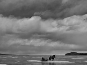 A horse and sledge on a frozen lake