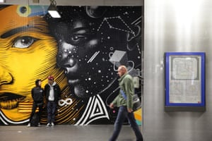 Douronne, his partner Elodie, and their newly installed mural. Gare du Nord Quai 36 art project