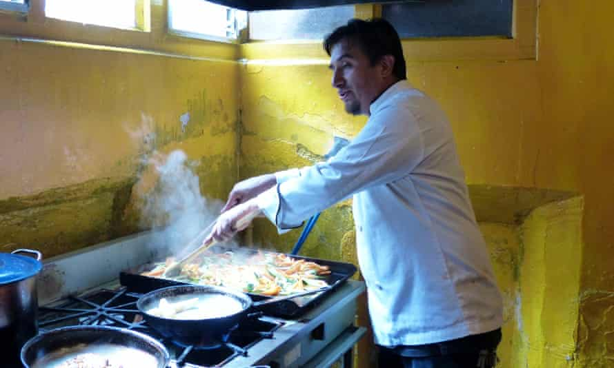 Willy Barreno cooking at Cafe Red.