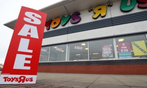Sale signs outside a Toys R Us store in Basingstoke, Hampshire.
