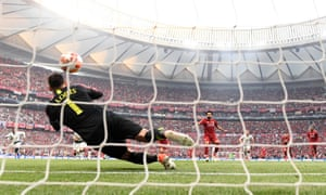 Mohamed Salah steps up to slam the ball past Spurs keeper Hugo Lloris and give Liverpool the lead.