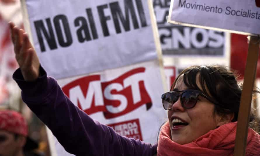 Demonstrators hold signs that read 'No to the IMF' in Buenos Aires