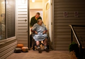 Henry Provencher, 87, is wheeled out of Redwood Retreats, a residential care facility by owner Eric Moessing while evacuating due to the Kincade Fire in Santa Rosa, California on 26 October 2019.