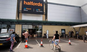 Halfords has been operating 335 of its 446 retail shops under a 'dark store' model during the lockdown, meaning customers have been placing orders with staff outside the front of the store.