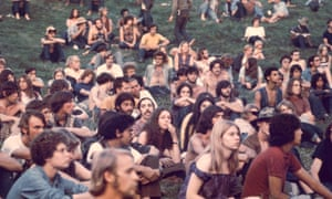 People watch a performance at the Woodstock Music and Arts Fair, in Bethel, New York, in August 1969.