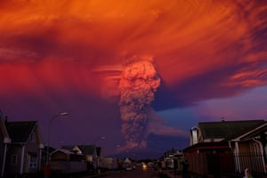 The Calbuco volcano from Puerto Montt, located 621 miles (1,000 km) south of Santiago in Chile. The 22 April 2015 eruption blew a smoke column 20 km high, with authorities declaring a red alert and ordering the evacuation of about 15,00 people.